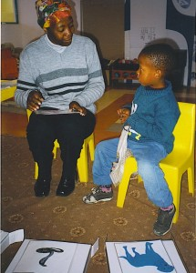 Child in South Africa doing cognitive flexibility and word learning tests